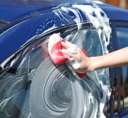 bigstock_Blue_car_washing_on_open_air_14775338
